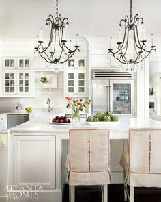 Kasler subtly incorporated Meghan's favorite hue into the kitchen via terracotta Marvic contrast fabric on the feminine counterstool slipcovers.