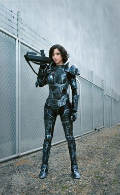 Angela Bermudez looks stunningly amazing as a kick-ass female Shepard in this detailed Mass Effect cosplay outfit. The photos were taken by Andres H.