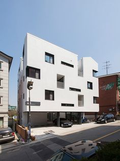 This Seoul residential block was designed by local studio Archihood WXY to look like a cluster of four buildings, with each facade featuring a gabled profile in just one corner.