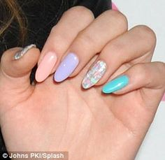 Nailed it: Chloe showed off her multi-coloured manicure
