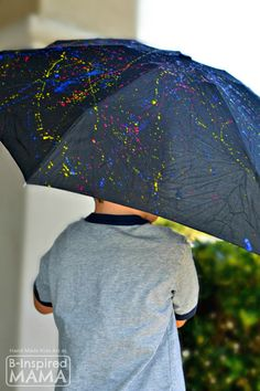 What's the craziest thing you've ever let your kids paint on?   Jackson Pollock Inspired Action-Painted Umbrella Kids Art Activity - Perfect for Spring - at B-Inspired Mama