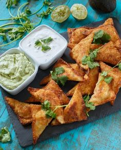 Southwest Wontons with a Lime Crema and an Avocado Cream made with Greek Yogurt.    Such an addictive party app!!