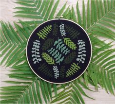 """Ferns, ferns, ferns! This pattern will bring the outdoors in! This pattern was made for black cloth but would look very nice on something lighter as well. PDF includes: - color photo of finished product - color pattern (split into multiple pages for ease of reading) - black and white pattern (split into multiple pages for ease of reading) - list of thread colors (DMC) - on screen pattern for those who prefer to use their computer or tablet while stitching!  Finished size: - 10"""" wide x 10""""…"""