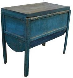 19th century Shenandoha Valley Virginia Baker's Table in wonderful old blue paint,. It has a hinged lid with a sliding bread board, barrel shped bottom, which is tin with wooden sides .