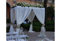 """Canopy Top Floral w/ Posy Accents - Floral """"hedge"""" along front and left and right side of canopy top. Four floral posies are added to accent the post gathers. #bydzign #bydzignfloral #weddings #floral For more info/ideas visit www.bydzign.com"""