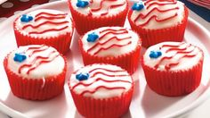 Stars and Stripes Cupcakes!! Create fireworks with easy-mix red, white and blue cupcakes. #4ofJuly #july4th