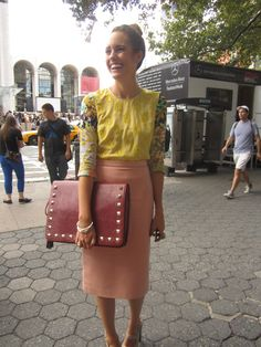 yellow print sleeved top with peach pencil skirt... Idk of I'd actually a bag like that but like the outfit
