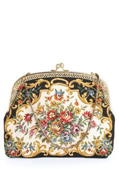 Vintage clutch ~ My 100 yr. old grandmother still carries a clutch exactly like this one!