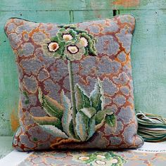 Lichen Auriculas, one of Kaffe's most subtle colourings, was part of a series he designed in the which included a pair of slippers and a waistcoat. A few years later we produced a wallpaper using the same lichen patterned background. Needlepoint Designs, Needlepoint Pillows, Needlepoint Stitches, Needlepoint Kits, Needlepoint Canvases, Needlework, Rug Hooking, Background Patterns, Textile Art