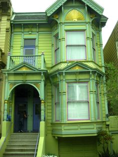 A typical Victorian row house with a bold paint job.  Close-up look shows how different colors can highlight the hallmark architectural detail of Victorians.