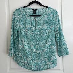 Split-neck top Split-neck flowy top in a teal paisley print. Gold clasp at the neckline, and a pleat down the middle. Worn only once. Fits best if you aren't too busty (which is the only reason I'm letting it go!). 100% polyester. H&M Tops Blouses