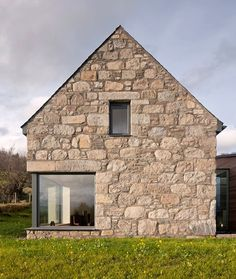 Gabled stone and glass Torispardon house reinterprets Scottish farm buildings.