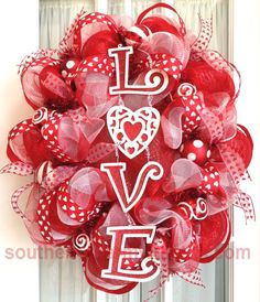 An oval deco mesh wreath for Valentine's Day! This oval wreath was made using a round wreath form.