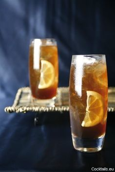 Long Island Iced Tea-1 part vodka,1 part tequila,1 part rum,1 part gin,1 part triple sec 1 1/2 parts sweet and sour mix, 1 splash Coca-Cola, put in shaker over ice, shake and serve over ice with lime.  Drive safe!