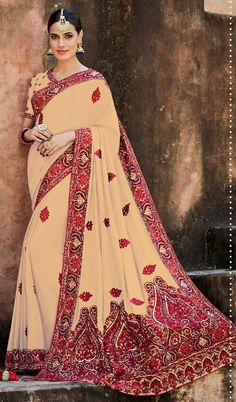 Beige latest Indian crepe silk partywear saree with heavy embroidered pallu