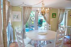 Fantasy shabby-chic dining room and artistic chandelier is dream-like in this Key West Wabi Sabi | Key West Rentals