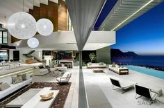 The Nettleton House is a modern and luxury beach mountain house in South Africa, designed by Stefan Antoni Olmesdahl Truen Architects.
