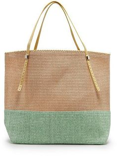 Ultralight and summery, this Mango two-tone straw bag is all you could ever want. #summer