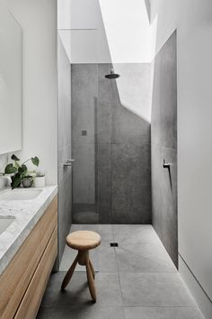 grey flooring Bathroom Shower Design // loving the light wood cabinets and how they cut the grey floor tile in this shower // Bathroom Tile Designs, Bathroom Renos, Modern Bathroom Design, Bathroom Interior Design, Bathroom Flooring, Bathroom Renovations, Bathroom Ideas, Bathroom Tiling, Shower Bathroom