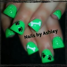 Short flare neon green sparkle gel nails with paw prints and a dog bone
