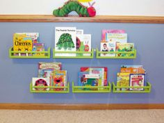 Would love to do this to Ryan's room. IKEA spice racks for books for little hands to reach.