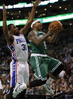 Boston Celtics' Isaiah Thomas (4) drives past Philadelphia 76ers' Hollis Thompson (31) during the second quarter of an NBA basketball game in Boston, Wednesday, Oct. 28, 2015.