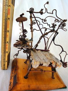 This listing is for a lovely piece of fairy furniture, handmade with twigs, sprigs, scraps, bark, and other fancy stuff. The chair measures seven inches