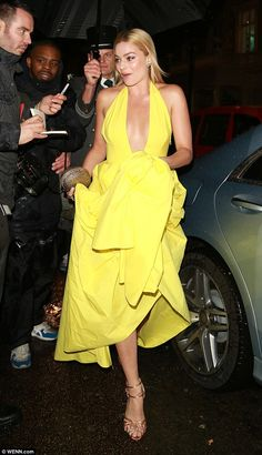 Wow thing: Hitching her dress up so it wouldn't get wet in the London weather, Margot looked every inch the Hollywood superstar