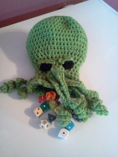 Crocheted Cthulhu DnD Dicebag.  I think the player who shows up with this gets automatic Wisdom and Intelligence points, and also Charisma for being fracking awesome.  That is all.