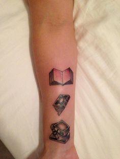 Book tattoo on wrist.