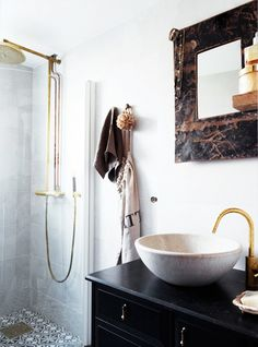 I'm obsessed with beautiful bathroom sinks. This one is gorgeous. Look We Love: Gold Fixtures in the Bathroom Apartment Interior, Home Interior, Bathroom Interior, Interior Modern, Stockholm Apartment, Eclectic Bathroom, Design Bathroom, Modern Bathroom, Interior Ideas