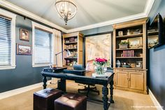 Let's talk about that dark wall paint adn those warm wood bookcases. Study Office, Ceo Office, Essential Elements, Elements Of Design, Office Decor, Entryway Tables, Gallery Wall, New Homes, Interior Design