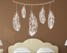 Feather wall cling above crib