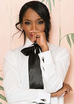 Dressed Formal In White Shirt And Black Bow