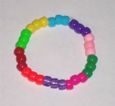 Girl scout law bracelet.  Could use dark blue for daisy or brown for brownies to separate the colors also.