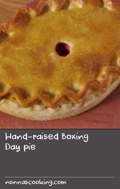 Hand-raised Boxing Day pie |      Make the most of Christmas dinner leftovers with a turkey, stuffing and cranberry pie made with hot water crust pastry.