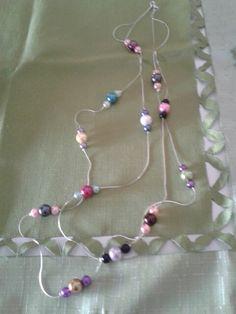 Collana lunga a due fili con perle in vetro in vari colore...(15,00)