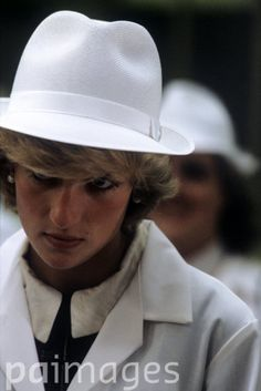 September 7, 1983: Princess Diana dressed in a white factory coat & hat tours the Keiller Marmalade & Sweet Factory in Dundee, Scotland.