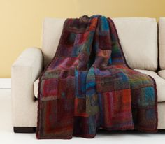 Image of Colorful Mitered Afghan made with Lion Brand Amazing yarn.   LOVE