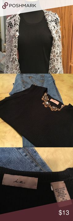 Black Tank Sweater Very versatile black tank. This blouse is preowned and in excellent condition. Size medium. ie Tops Tank Tops