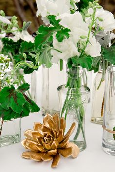 white + green centerpieces with pops of gold // photo by Katherine O'Brien Photography, flowers by Bouquets of Austin // View more: http://ruffledblog.com/austin-garden-wedding/