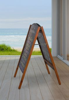 Use a sandwich blackboard to show menu items, nightly music, & more outside your location! The classic timber frame with write on black board makes creating adverts easy. Order by EST for same day Australia-wide despatch! Cafe Menu Boards, Exhibition Display Stands, Menu Items, Blackboards, Flipping, Signage, Sandwiches, Messages, Canning
