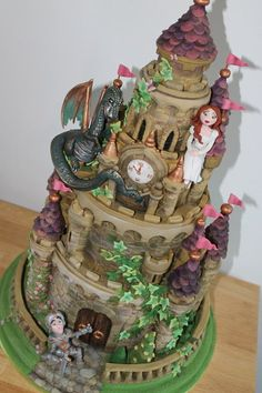castle cake with added dragon, knight and princess Cake by Zoe's Fancy Cakes