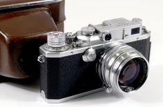 Canon II S2 1955 - a first generation rangefinder, very similar to the pre-WWII Leica III copies and using the Leica M39 lens mount, but with a combined rangefinder/viewfinder window.  Canons from 1946 to 1955 looked nearly identical to this camera.  In all ways this was a Canon IV (4), but with a maximum 1/500th shutter speed (one stop slower).