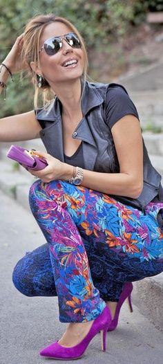street style...i love this!  tough leather with floral pants and purple pumps!