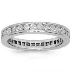 Gleaming in absolute perfection, this lovely diamond eternity band is handcrafted in lustrous 18K white gold. Small round cut diamonds are channel set all the way across the band and total to 1.41 carats. The band measures to 1/8 inches in width and weighs approximately 4.6 grams. This lovely diamond eternity band is an ideal gift for that special someone. $1,673.00