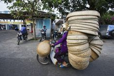 Vietnam's Motorbikes Carry Mind-Boggling Loads of Stuff. Photography by Hans Kemp.