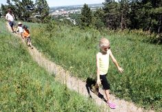 Sophie Schmid, 8, leads her two siblings, Leo and Isabel, and father, Petter, along a trail at the Skyline Wilderness Park on Saturday afternoon. The park will receive a $900,000 facelift from city Vision Funds. #Skyline #hiking #RapidCity #SouthDakota
