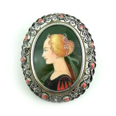 800 Silver Mediterranean Red Coral Hand Painted Portrait Pendant Pin. We really like featuring hand painted items such as this because they symbolize the link between art and jewelry. You can notice some of the brush strokes and stippling effects if you look closely.  Check out more antique and vintage jewelry at Regalities.com