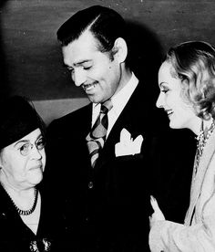 Original caption:  Clark Gable is pictured with his bride, blonde Carole Lombard, as he greeted his now mother-in-law, Mrs. Elizabeth Peters. Gable and Lombard were married in a surprise elopement to Kingman, Arizona. The Actor and his actress-bride will make their home in the large rambling ranch house in San Fernando Valley which he has been preparing for his bride. There they expect to ranch and farm in keeping with the Hollywood 'back-to-the-soil' trend. (March 30, 1939)